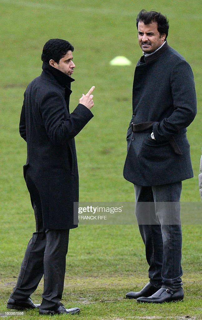 Chairman of the Paris Saint-Germain L1 football club, Nasser Al-Khelaifi (L) of Qatar gestures next to Qatari Crown Prince and PSG owner Tamim bin Hamad Al-Thani during a training session on January 30, 2013 at the Camp des Loges in Saint-Germain-en-Laye, west of Paris. AFP PHOTO / FRANCK FIFE