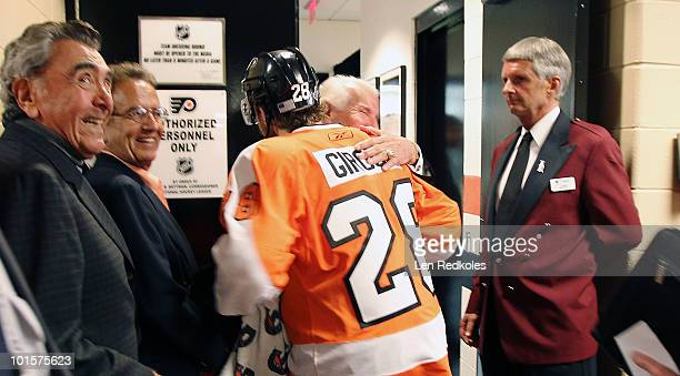 Chairman of the Philadelphia Flyers Ed Snider congratulates Claude Giroux after scoring the gamewinning goal in overtime to defeat the Chicago...