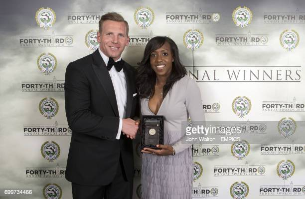 Chairman of the Professional Footballers' Association Ritchie Humphreys presents Arsenal's Danielle Carter with the PFA Womens Team of the Year Award...