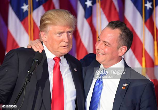 Chairman of the Republican National Committee Reince Priebus hugs Republican presidential elect Donald Trump during election night at the New York...