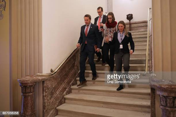 Chairman of the Republican Study Committee Rep Mark Walker talks to reporters as he moves throught the US Capitol March 23 2017 in Washington DC...