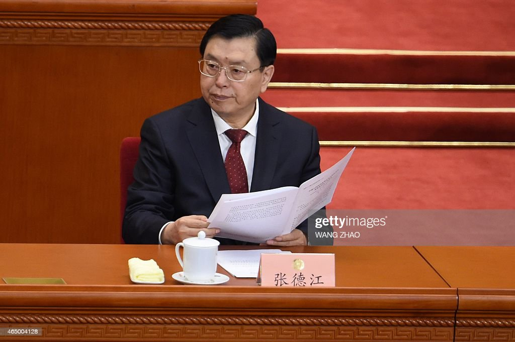 Chairman of the Standing Committee of China's National People's Congress (NPC), Zhang Dejiang attends the opening session of the Chinese People's Political Consultative Conference (CPPCC) at the Great Hall of the People in Beijing on March 3, 2015. Thousands of delegates from across China and the Chinese leadership will gather for its annual legislature meetings from March 3 in Beijing. AFP PHOTO / WANG ZHAO