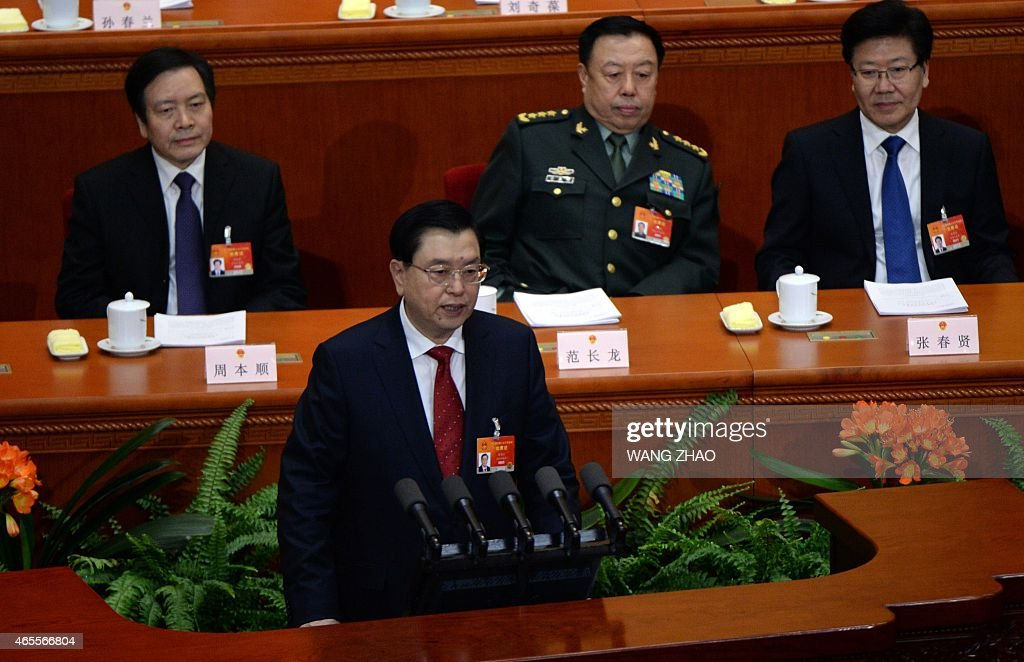 Chairman of the Standing Committee of the National People's Congress Zhang Dejiang delivers his work report during the third session of the 12th National People's Congress at the Great Hall of the People in Beijing on March 8, 2015. China's Communist Party-controlled legislature, the National People's Congress (NPC), gathers in the capital for the annual show of political theater, with the 'rule of law' high on the agenda. AFP PHOTO / WANG ZHAO