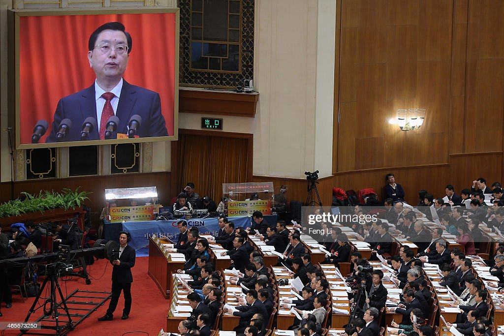 Chairman of the Standing Committee of the National People's Congress Zhang Dejiang delivers the work report during the second plenary session of China's parliament, the National People's Congress (NPC), at the Great Hall of the People on March 8, 2015 in Beijing, China. China plans to develop national legislation to fight corruption, according to the work report delivered by Chairman of the Standing Committee of the NPC Zhang Dejiang Sunday.