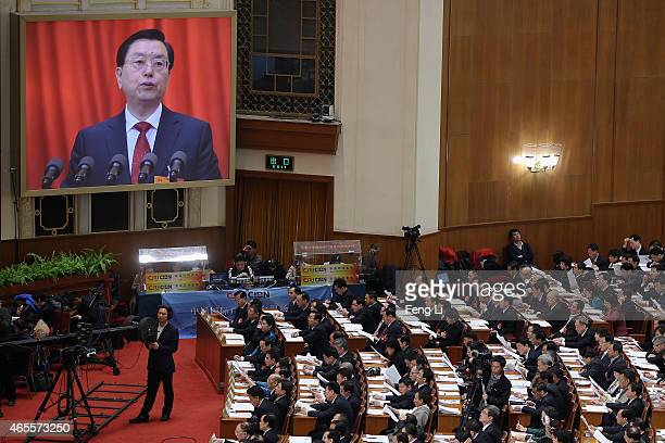 Chairman of the Standing Committee of the National People's Congress Zhang Dejiang delivers the work report during the second plenary session of...