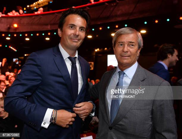 Chairman of the Supervisory Board of French media group Vivendi Vincent Bollore and his son French advertising group Havas CEO Yannick Bollore pose...