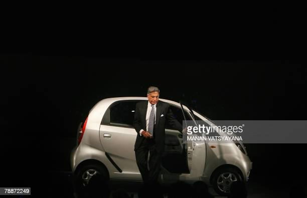 Chairman of the Tata Group Ratan Tata comes out of the new Tata 'Nano' car in New Delhi 10 January 2008 India's giant Tata Group unveiled a USD 2500...