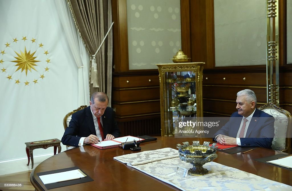 Chairman of the Turkey's ruling Justice and Development (AK) Party Binali Yildirim (R) meets with Turkish President Recep Tayyip Erdogan (L) at the Presidential palace to submit a list of Cabinet ministers for presidential approval in Ankara, Turkey on May 24, 2016.