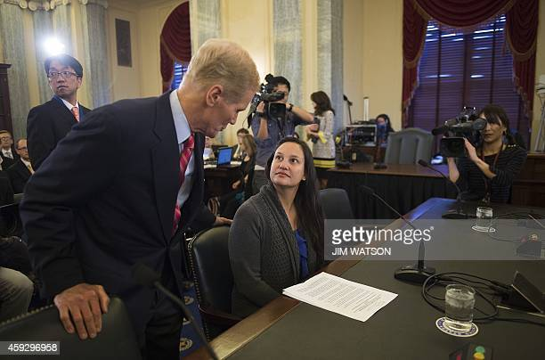 Chairman of the US Senate Committee on Commerce Science and Transportation Bill Nelson DFL talks with Air Force Lt Stephanie Erdman whose eye was...