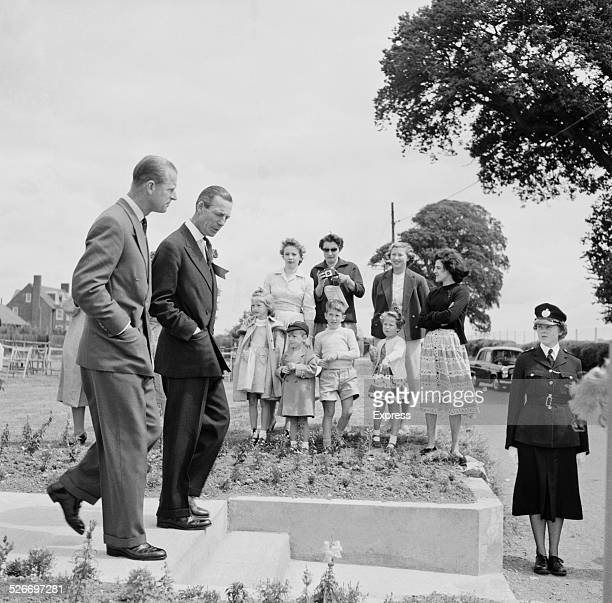 Chairman of the Village Committee Duncan Alexander shows Prince Philip Duke of Edinburgh the Empire Games Village in Cardiff Wales 23rd July 1958