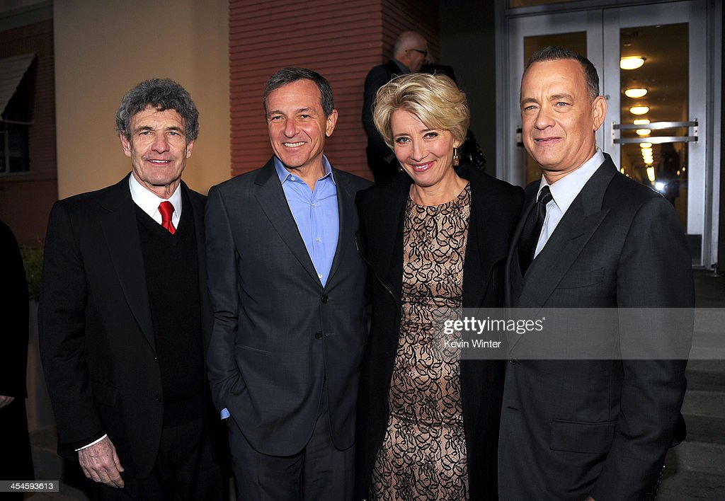 Chairman of the Walt Disney Studios Alan Horn, Chairman and Chief Executive of The Walt Disney Company Bob Iger, actors Emma Thompson and Tom Hanks attend the U.S. premiere of Disney's 'Saving Mr. Banks', the untold backstory of how the classic film 'Mary Poppins' made it to the screen, at the Walt Disney Studios on December 9, 2013 in Burbank, California. The film opens this Holiday season.