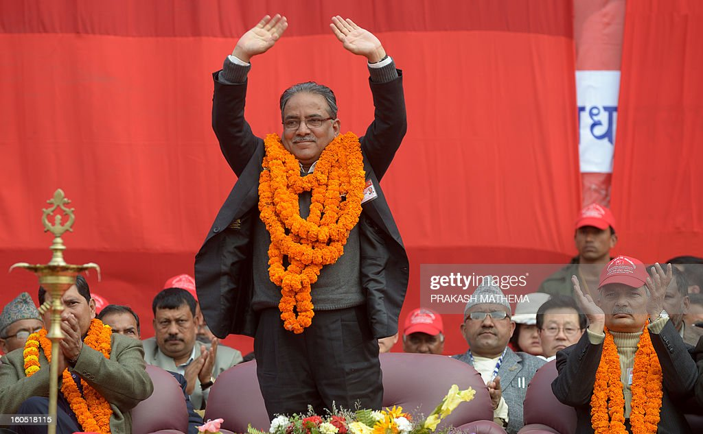 Chairman of Unified Communist Party of Nepal (Maoist), Pushpa Kamal Dahal known as Prachanda waves to the crowd during the inauguration of the Unified Communist Party of Nepal (Maoist) general convention at Hetauda, some 100 kms south of Kathmandu on Febuary 2, 2013. Thousands of Nepal's former rebel Maoists gathered Saturday for their biggest show of strength since taking up arms in a 10-year insurgency and toppling the world's last Hindu monarchy. AFP PHOTO/Prakash MATHEMA