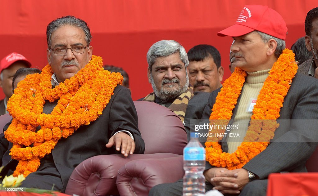 Chairman of Unified Communist Party of Nepal (Maoist), Pushpa Kamal Dahal known as Prachanda (L) and Nepalese Prime Minister Baburam Bhattarai (R) attend the inauguration of the Unified Communist Party of Nepal (Maoist) general convention at Hetauda, some 100 kms south of Kathmandu on Febuary 2, 2013. Thousands of Nepal's former rebel Maoists gathered Saturday for their biggest show of strength since taking up arms in a 10-year insurgency and toppling the world's last Hindu monarchy. AFP PHOTO/Prakash MATHEMA