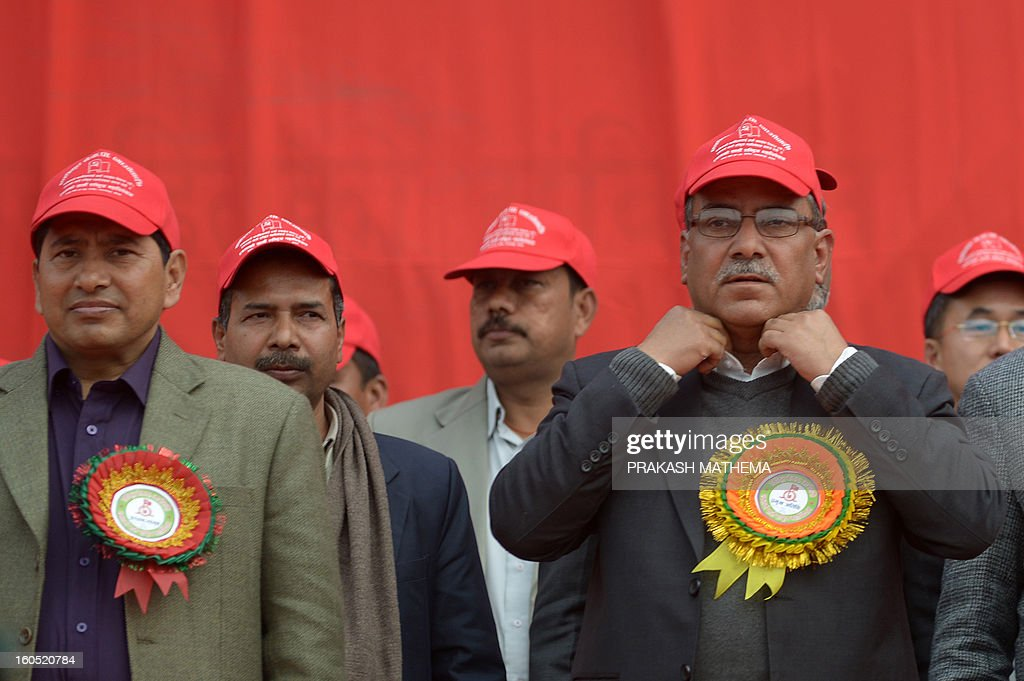 Chairman of Unified Communist Party of Nepal (Maoist), Pushpa Kamal Dahal known as Prachanda (R) attends the inauguration of the Unified Communist Party of Nepal (Maoist) general convention at Hetauda, some 100 kms south of Kathmandu on Febuary 2, 2013. Thousands of Nepal's former rebel Maoists gathered Saturday for their biggest show of strength since taking up arms in a 10-year insurgency and toppling the world's last Hindu monarchy. AFP PHOTO/Prakash MATHEMA