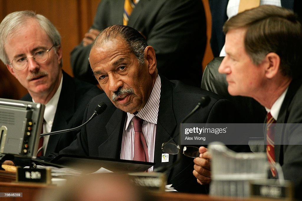 Chairman of US House Judiciary Committee Rep John Conyers speaks as his counsel and Rep Lamar Smith listen during a mark up July 25 2007 on Capitol...