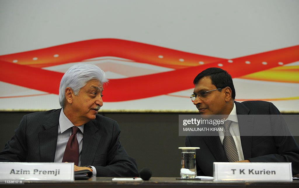 Chairman of Wipro, Azim H. Premji (L) and Chief Executive Officer, T.K. Kurien interact during a press conference to announce the company's financial results for the fourth quarter of the year 2011-12 at Wipro's facility in Bangalore on April 25, 2012. India's third-largest software company Wipro posted a 7.7 percent year-on-year rise in net profit for the January-March period, but a muted forecast sent its shares tumbling. AFP PHOTO/Manjunath KIRAN