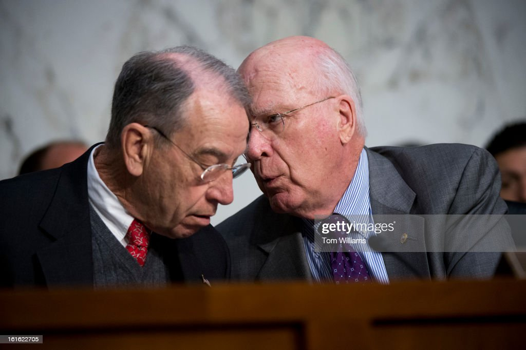 Chairman Pat Leahy, D-Vt., right, has a word with Sen. Chuck Grassley, R-Iowa, ranking member, while Homeland Security Secretary Janet Napolitano testifies before a Senate Judiciary Committee hearing in Hart Building entitled 'Comprehensive Immigration Reform.'