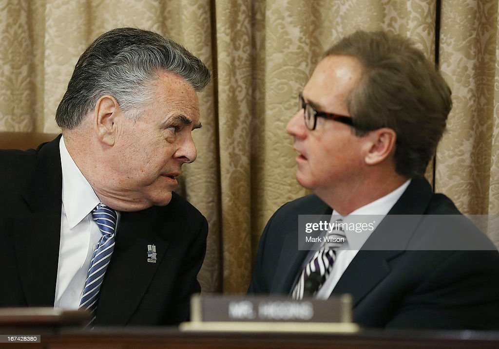 Chairman Peter King (R-NY)(L) talks with Rep. Brian Higgins (D-NY) during a House Homeland Security Counterterrorism and Intelligence Subcommittee hearing on Capitol Hill, April 25, 2013 in Washington, DC. The committee is hearing testimony on counterterrorism and ways to fight chemical, biological, biological, and nuclear attacks on the United States.