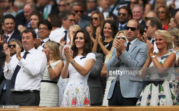Chairman Philip Brook Prince William Duke of Cambridge and Catherine Duchess of Cambridge and Gill Brook applaud from the centre court royal box...