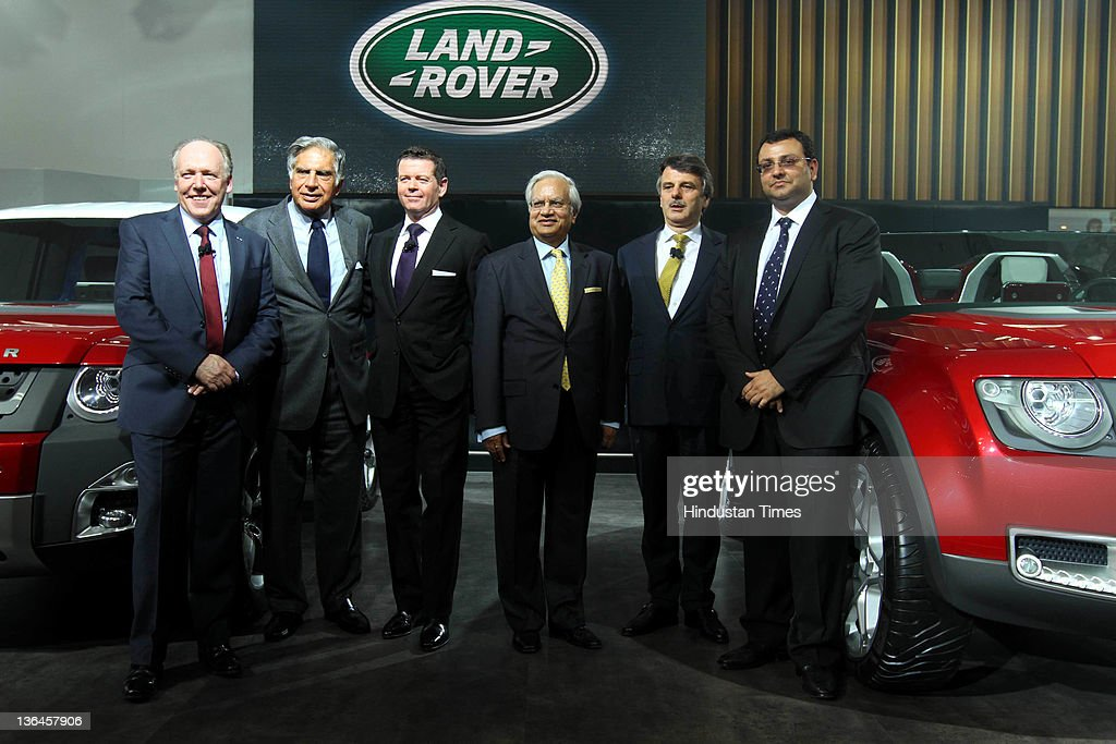 Chairman <a gi-track='captionPersonalityLinkClicked' href=/galleries/search?phrase=Ratan+Tata&family=editorial&specificpeople=649518 ng-click='$event.stopPropagation()'>Ratan Tata</a> (2nd L) with <a gi-track='captionPersonalityLinkClicked' href=/galleries/search?phrase=Cyrus+Mistry&family=editorial&specificpeople=8705051 ng-click='$event.stopPropagation()'>Cyrus Mistry</a> (R), Deputy Chairman and Chairman-Designate of Tata Group, pose for photos at the Land Rover pavilion during 11th Auto Expo held at Pragati Maidan on January 5, 2012 in New Delhi, India. Tata Motors-owned Land Rover showcased two new models, Defender Concept 100 and Defender Concept 100 Sport car here at Auto Expo 2012.