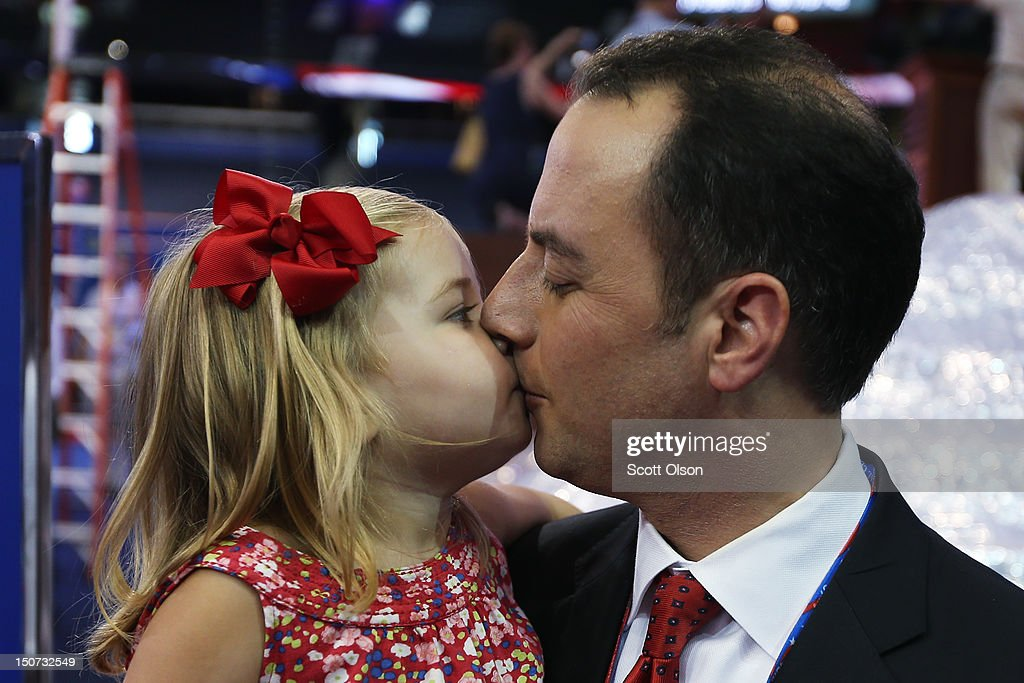 Chairman <a gi-track='captionPersonalityLinkClicked' href=/galleries/search?phrase=Reince+Priebus&family=editorial&specificpeople=7419119 ng-click='$event.stopPropagation()'>Reince Priebus</a> kisses his daughter Grace Priebus, 2 years, as he stands with family ahead of the Republican National Convention at Tampa Bay Times Forum on August 25, 2012 in Tampa, Florida. Area residents are preparing for Tropical Storm Isaac just before the Republican National Convention which will be held at the Tampa Bay Times Forum during the week of August 27th.