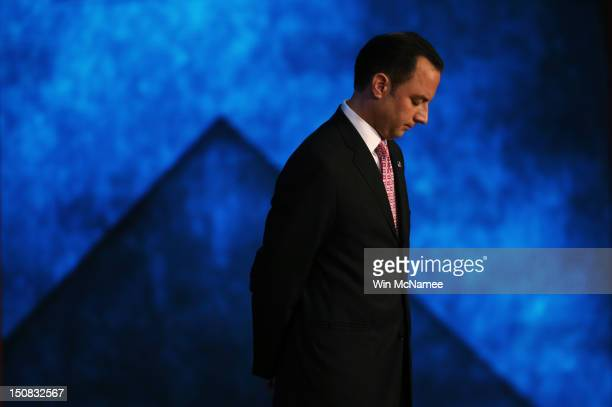 Chairman Reince Priebus stands on stage during teh start of the Republican National Convention at the Tampa Bay Times Forum on August 27 2012 in...