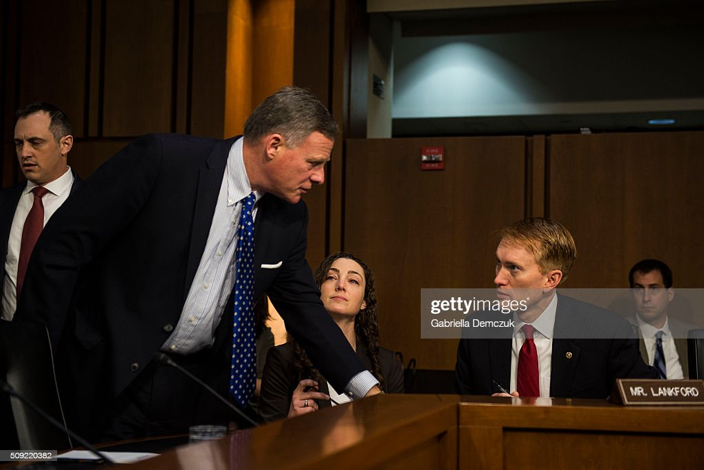 Chairman Richard Burr (R-NC) speaks to Sen. James Lankford (R-OK) before the Senate (Select) Intelligence Committee hearing at the Hart Senate Building on February 9, 2016 in Washington, D.C. The committee met to hear testimony about worldwide threats to America and its allies.