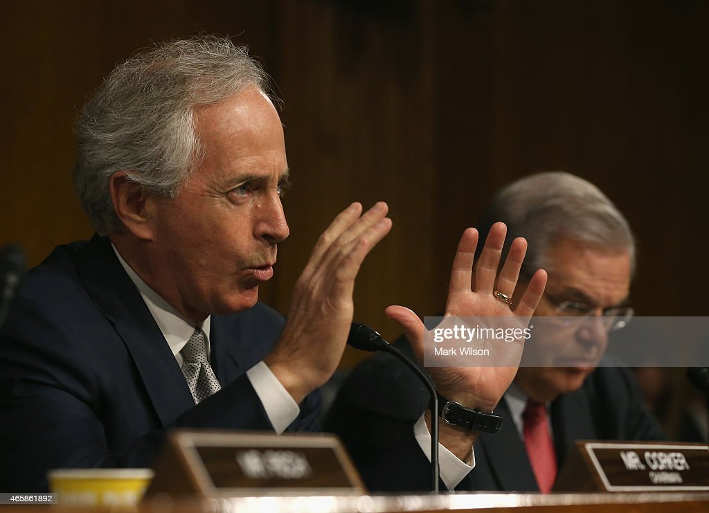 Chairman Sen. <a gi-track='captionPersonalityLinkClicked' href=/galleries/search?phrase=Bob+Corker&family=editorial&specificpeople=3986296 ng-click='$event.stopPropagation()'>Bob Corker</a> (R-TN) (L) speaks while flanked by ranking member Sen. Bob Menendez (D-NJ) during a Senate Foreign Relations Committee hearing on Capitol Hill, March 11, 2015 in Washington, DC. The committee was hearing testimony from top administration officials on President Obamas request to Congress for authorization to use force against ISIS.