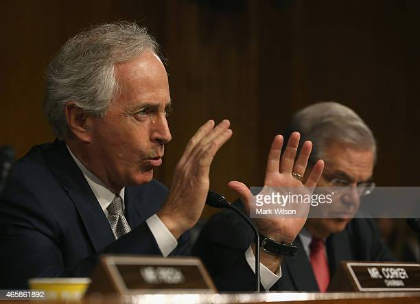 Chairman Sen Bob Corker speaks while flanked by ranking member Sen Bob Menendez during a Senate Foreign Relations Committee hearing on Capitol Hill...
