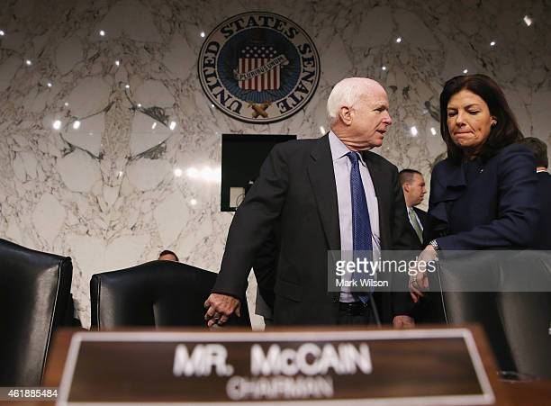 Chairman Sen John McCain talks with US Sen Kelly Ayotte before the start of a Senate Armed Services Committee hearing on Capitol Hill January 21 2015...
