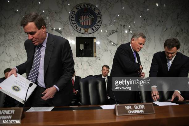 Chairman Sen Richard Burr and Vice Chairman Sen Mark Warner arrive at a hearing before the Senate Intelligence Committee June 21 2017 on Capitol Hill...