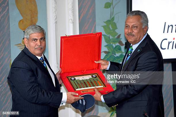 Chairman Shashank Manohar makes presentation to outgoing ICC president Zaheer Abbas during the ICC Full Council meeting at The Waldorf Astoria The...