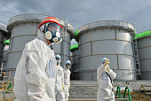 NRA Chairman Shunichi Tanaka inspects storage tanks holding water contaminated with radioactive substances at the Fukushima Daiichi Nuclear Power...
