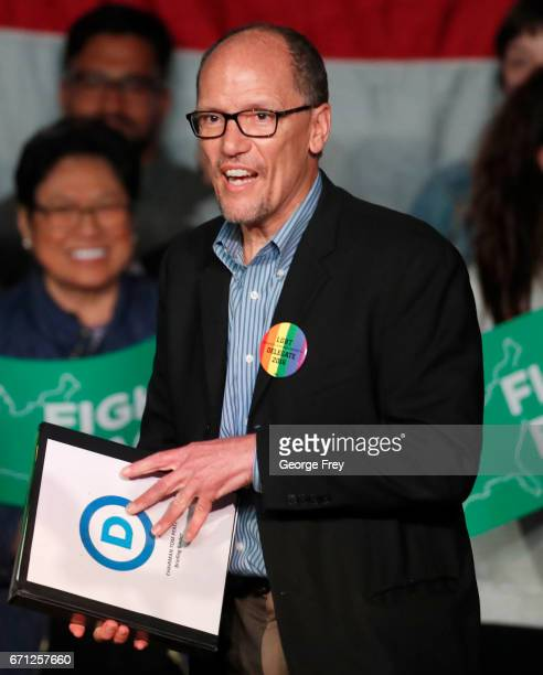 Chairman Tom Perez walks on stage to speak to a crowd of supporters at a Democratic unity rally at the Rail Event Center on April 21 2017 in Salt...