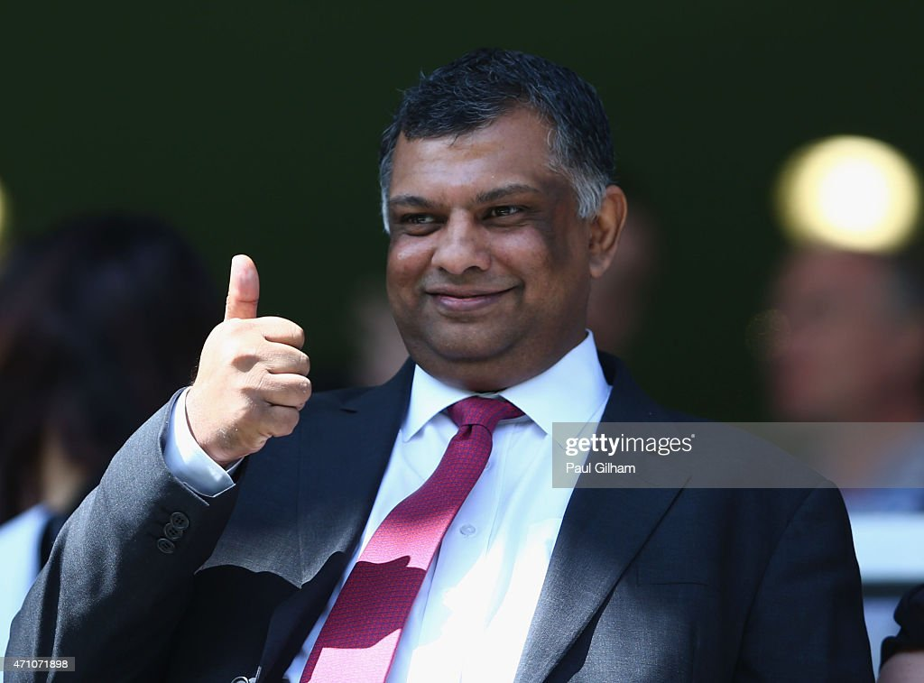 Chairman Tony Fernandes gives the thumbs up during the Barclays Premier League match between Queens Park Rangers and West Ham United at Loftus Road on April 25, 2015 in London, England.