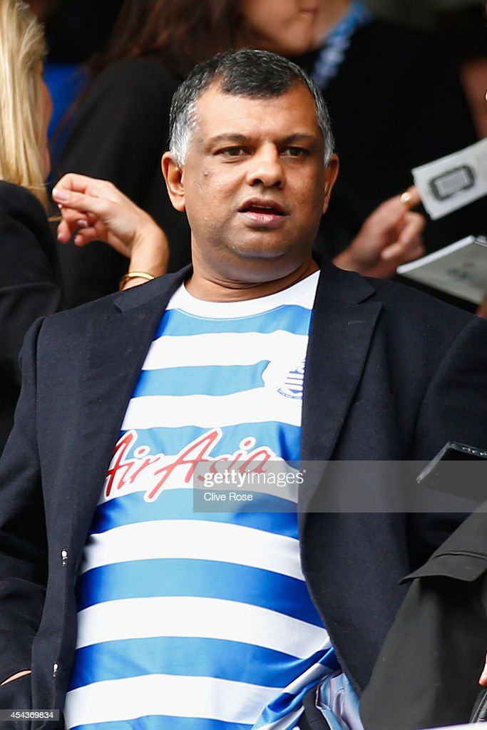 Chairman <a gi-track='captionPersonalityLinkClicked' href=/galleries/search?phrase=Tony+Fernandes&family=editorial&specificpeople=2103805 ng-click='$event.stopPropagation()'>Tony Fernandes</a> looks on during the Barclays Premier League match between Queens Park Rangers and Sunderland at Loftus Road on August 30, 2014 in London, England.