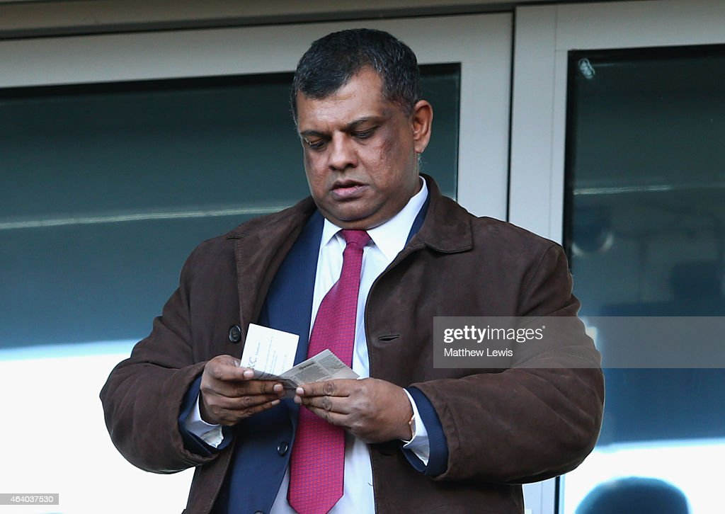 Chairman <a gi-track='captionPersonalityLinkClicked' href=/galleries/search?phrase=Tony+Fernandes&family=editorial&specificpeople=2103805 ng-click='$event.stopPropagation()'>Tony Fernandes</a> looks on prior to the Barclays Premier League match between Hull City and Queens Park Rangers at KC Stadium on February 21, 2015 in Hull, England.