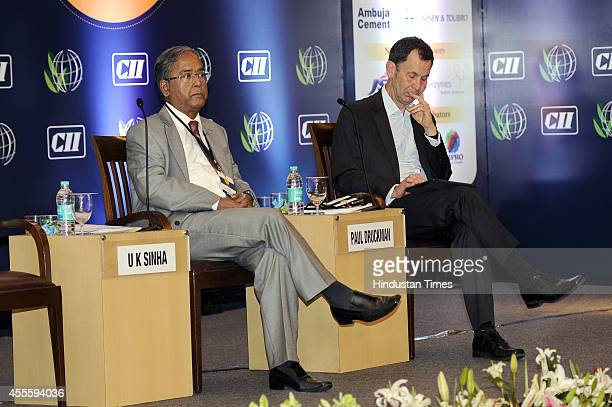 Chairman UK Sinha with IIRC CEO Paul Druckman during the 9th Sustainable and Inclusive Solutions Summit at hotel The Lalit on September 17 2014 in...