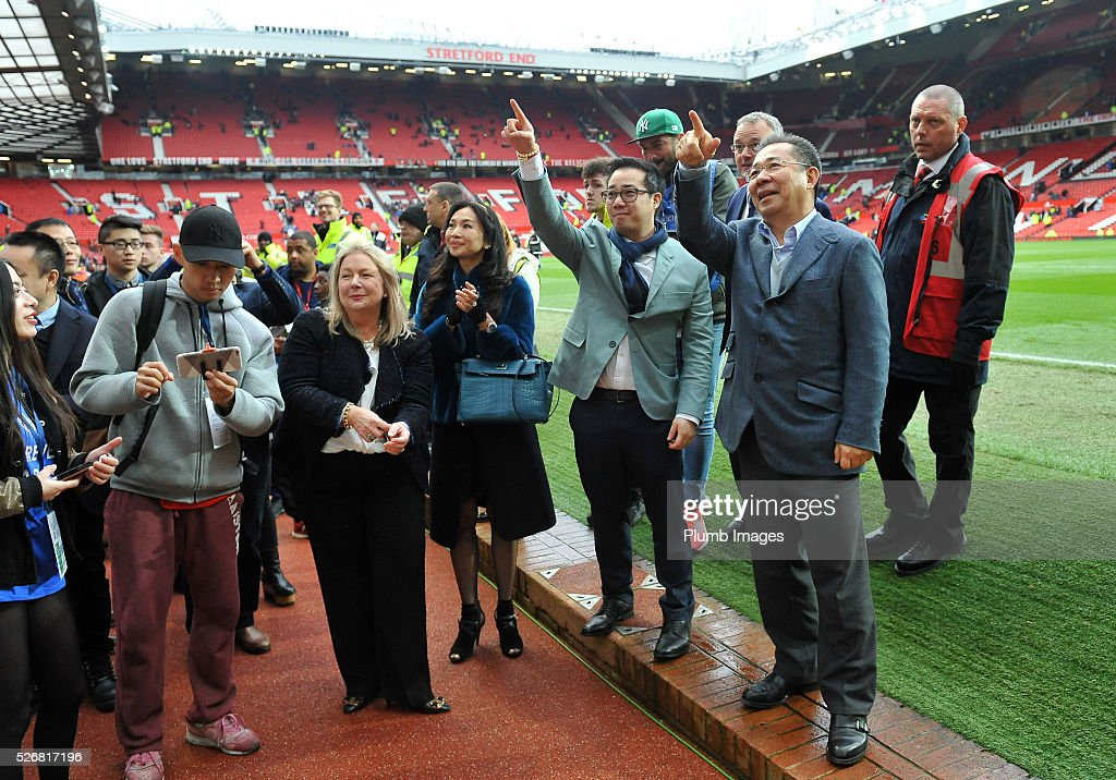 Chairman Vichai Srivaddhanaprabha and Vice Chairman Aiyawatt Srivaddhanaprabha of Leicester City applaud the travelling fans after the Premier League match between Manchester United and Leicester City at Old Trafford on May 01, 2016 in Manchester, United Kingdom.