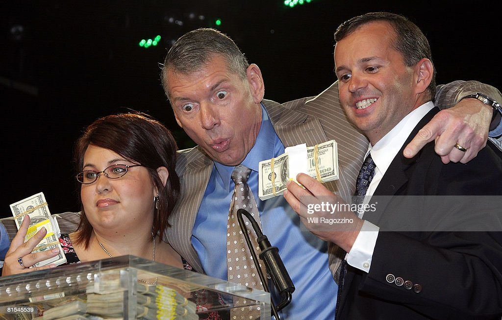 Chairman Vince McMahon (C) congratulates winners Sarah Furhman (L) and Steve Rosenzweig at the announcement of the First McMahon Million Dollar Mania Winners at the Hard Rock Cafe June 12, 2008 in New York City.