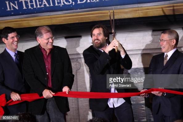 Chairman Walt Disney Studios Rich Ross director Robert Zemeckis actor Jim Carrey and David Lim attend the 'Disney's A Christmas Carol' train tour...