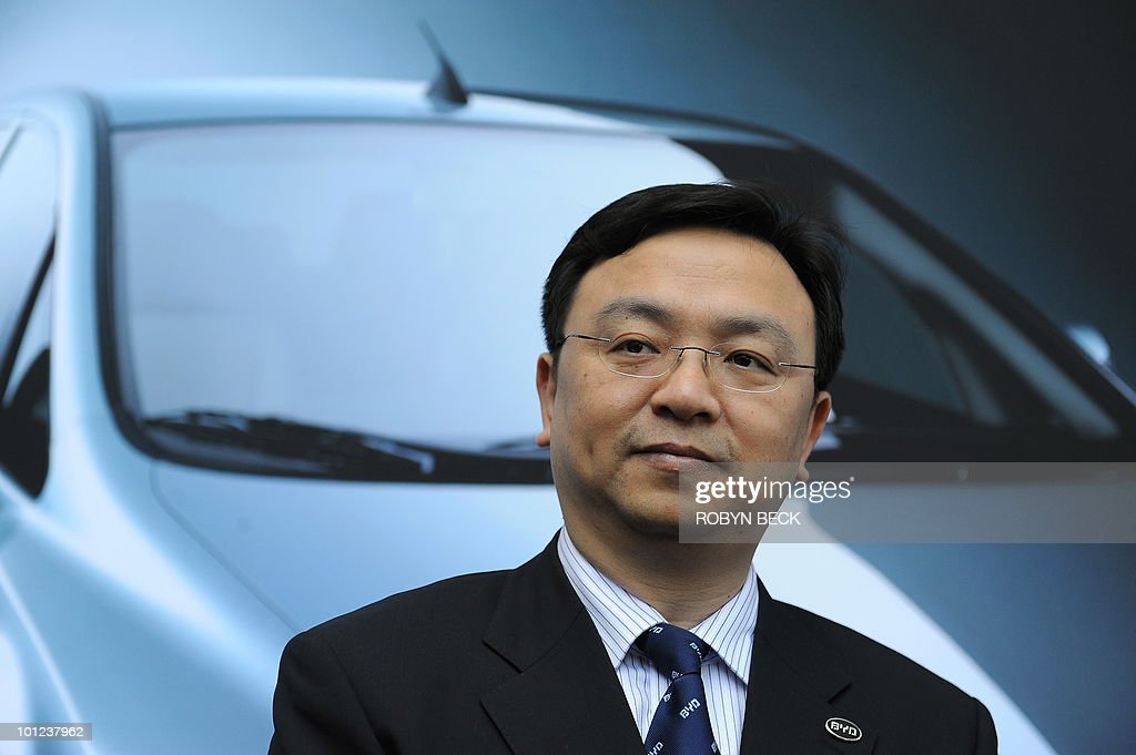 BYD Chairman Wang Chuanfu poses in front of a photo of BYD's e6 electric car at a press conference April 30, 2010 at Los Angeles City Hall to announce that the Chinese solar energy and automobile firm BYD will locate its US headquarters in Los Angeles, potentially creating hundreds of new jobs. BYD, which stands for Build Your Dreams, is a manufacturer of batteries, solar panels and electric-hybrid vehicles partly financed by billionaire Warren Buffett. BYD plans to introduce the e6 in China and the US later this year.
