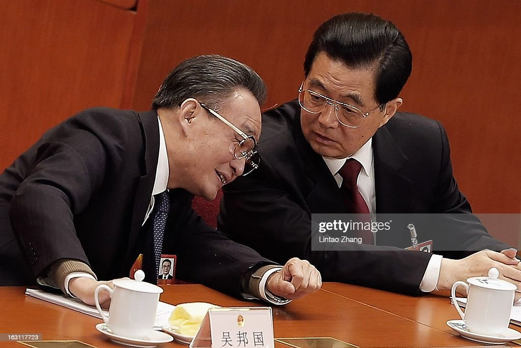 Chairman <a gi-track='captionPersonalityLinkClicked' href=/galleries/search?phrase=Wu+Bangguo&family=editorial&specificpeople=604934 ng-click='$event.stopPropagation()'>Wu Bangguo</a> (L) listens to Chinese President <a gi-track='captionPersonalityLinkClicked' href=/galleries/search?phrase=Hu+Jintao&family=editorial&specificpeople=203109 ng-click='$event.stopPropagation()'>Hu Jintao</a> during the opening session of the annual National People's Congress at Great Hall of the People on March 5, 2013 in Beijing, China. Over 2,000 members of the 12th National Committee of the Chinese People's Political Consultative, a political advisory body, are attending the annual session, during which they will discuss the development of China. Premier Wen Jiabao delivered an opening report focusing on goals of improved welfare provision, steady ecconomic growth while maintaining social stability.