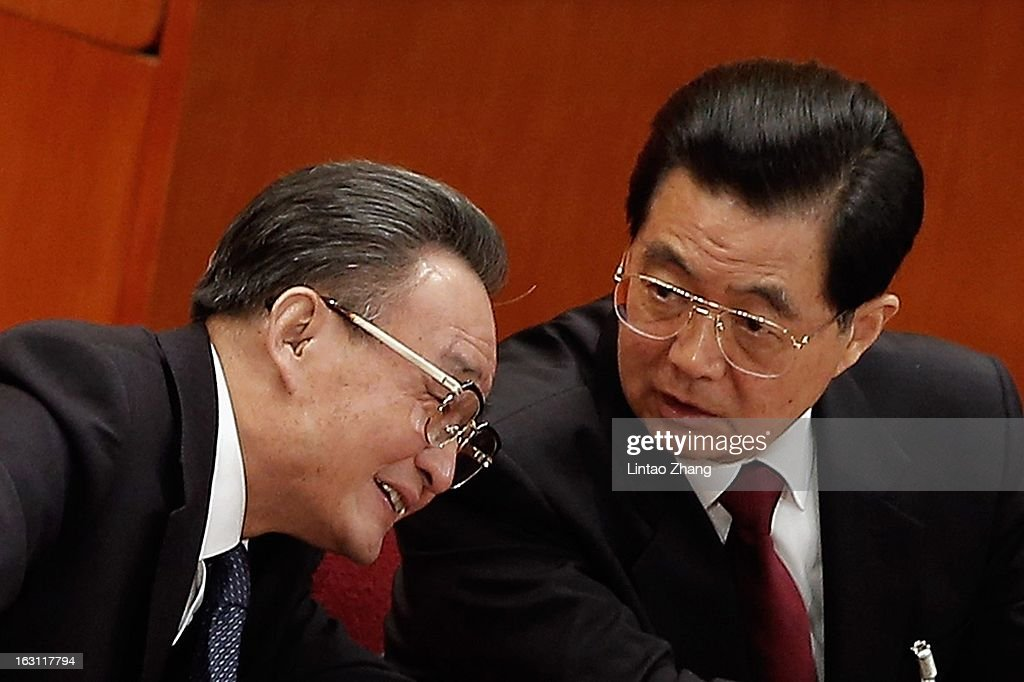 Chairman Wu Bangguo listens to Chinese President Hu Jintao during the opening session of the annual National People's Congress at Great Hall of the...