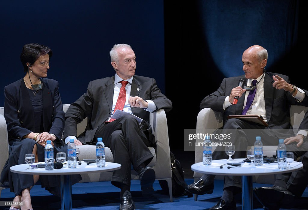Chairman/Co-founder of the Chertoff Group, and Former Secretary at the US Department of Homeland Security Michael Chertoff (R) speaks next to European Union Counter-terrorism Coordinator Gilles de Kerchove (C) and Interpol President of Mireille Ballestrazzi (L) during the opening plenary session of an Interpol international forum on Technology Against Crime (TAC) on July 8, 2013, in Lyon, southeastern France.
