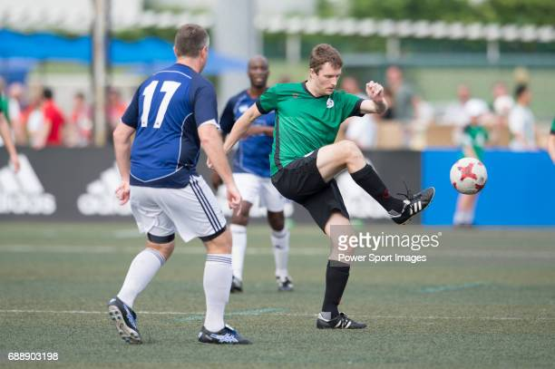Chairman's Select's Danny Beattie competes with Yau Yee League Masters's Gorka GarciaTapia for a ball during their Masters Tournament match part of...