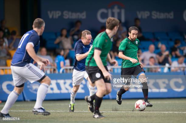 Chairman's Select's Jack Gallagher competes with Yau Yee League Masters's Gorka GarciaTapia for a ball during their Masters Tournament match part of...