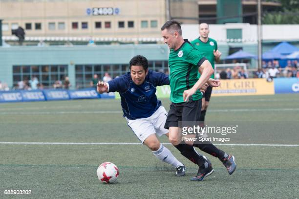 Chairman's Select's Pak Wai Wan competes with Yau Yee League Masters' Gorka GarciaTapia for a ball during their Masters Tournament match part of the...