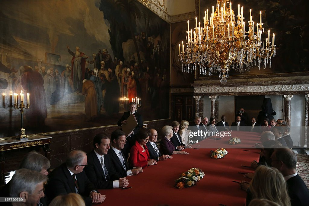 Chairmen of the Senate and the House and other ministers sign the Act of Abdication after Queen Beatrix of the Netherlands Prince WillemAlexander of...