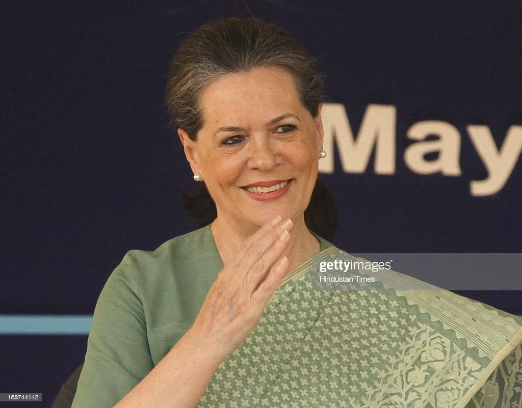 UPA Chairperson and Congress President Sonia Gandhi greets students after laying the foundation stone for a girls' hostel at Jamia Millia Islamia University on May 14, 2013 in New Delhi, India.